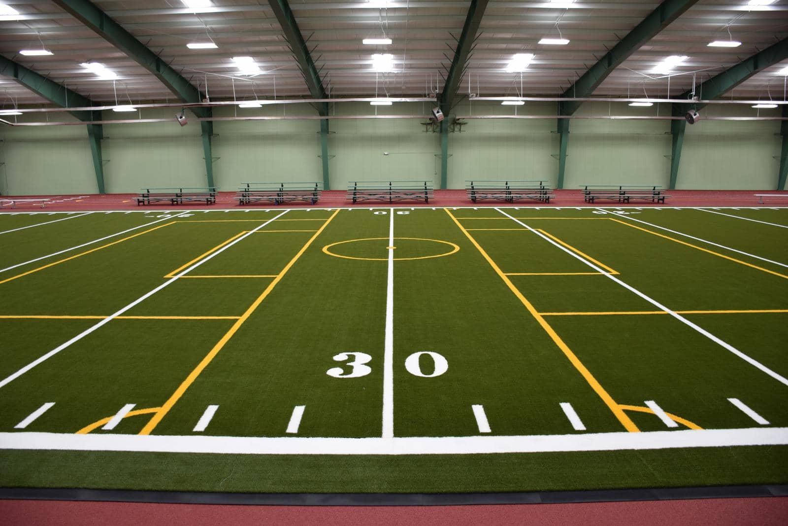 indoor sports field with artificial turf
