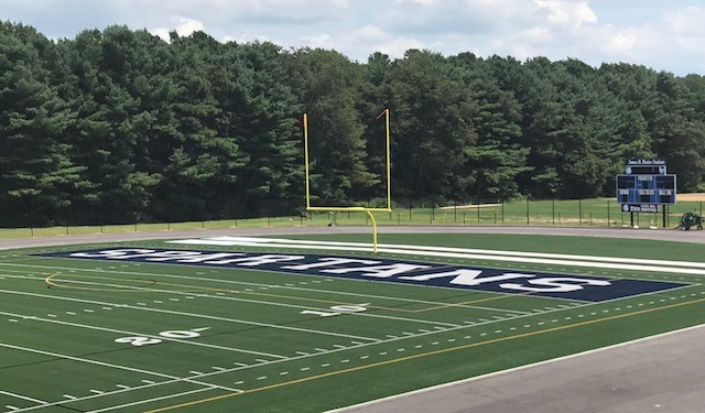 Artificial Turf Football Field with custom end zone lettering and center field logo