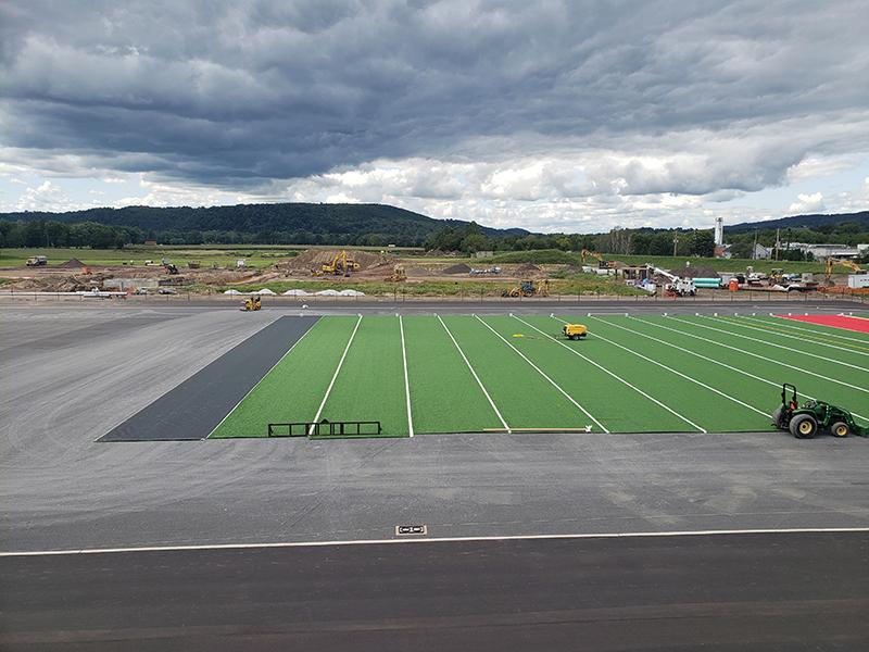 Installing Turf on Stadium at Bloom HS